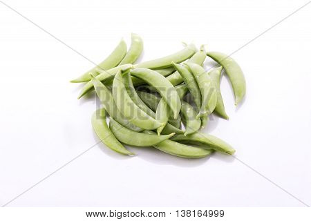 green pea pods and peas isolated over white background