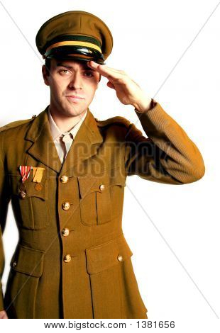 Man In Military Field Uniform With Hat Saluting