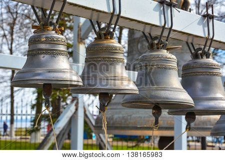 Group of bronze bells near the Orthodox church.