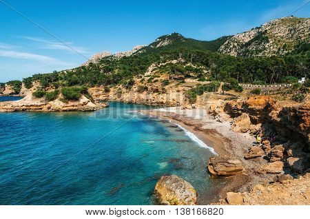 View of the bay with azure water wild beach Punta Llarga Mallorca Spain