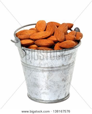 Old Tin Bucket With Almonds