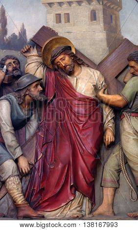 ZAGREB, CROATIA - SEPTEMBER 14: 5th Stations of the Cross, Simon of Cyrene carries the cross, Basilica of the Sacred Heart of Jesus in Zagreb, Croatia on September 14, 2015