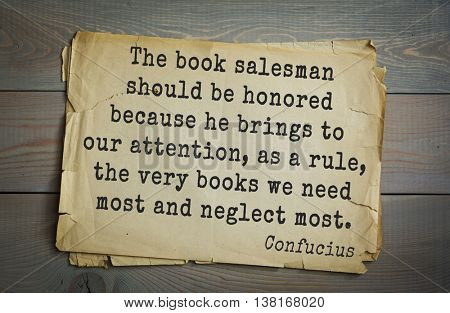 Ancient chinese philosopher Confucius quote on old paper background. The book salesman should be honored because he brings to our attention, as a rule, the very books we need most and neglect most.