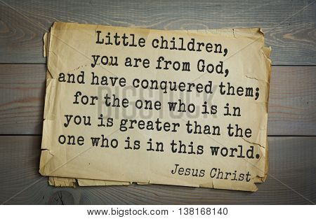 Jesus quote on old paper background. Little children, you are from God, and have conquered them; for the one who is in you is greater than the one who is in this world.