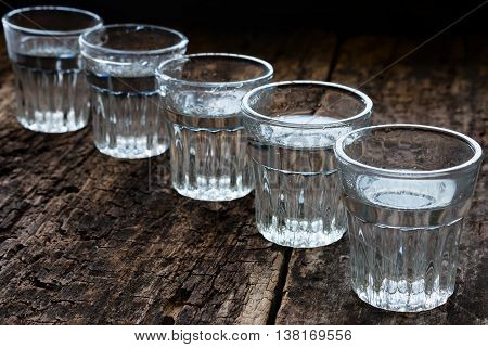Glasses Of Vodka On A Wooden Background