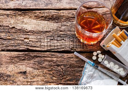 Alcohol, Cigarettes And Drugs On Wooden Background Template Space For Text