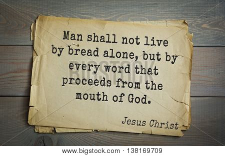 Jesus quote on old paper background. Man shall not live by bread alone, but by every word that proceeds from the mouth of God.