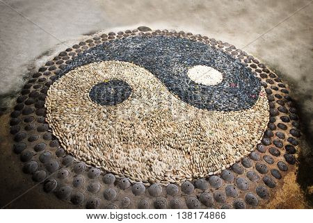 Yin Yang sign. Sort of symbolic stone.