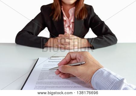 Businessman sign contract with businesswoman sitting at desk on white background.