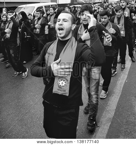 Istanbul Turkey - November 13 2013: The global mourning ceremony of Ashura. Azerbaijan Hz. Imam Hussain Group. Karbala Martyrs Commemoration in Arenamega. Thousands of Jaferies in Turkey joined the Karbala mourning ritual where Prophet Muhammad's grandson