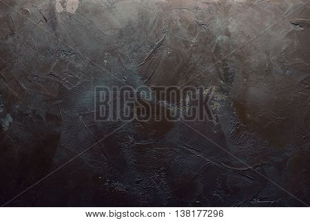 Texturized grey and brown putty with gradient light. Vintage or grungy background of venetian stucco texture as pattern wall. Horizontal view