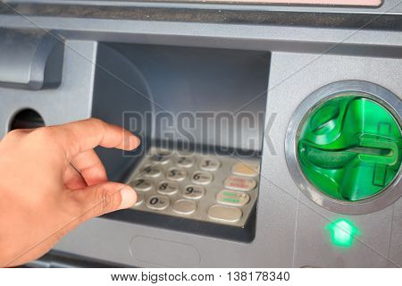 Abstract ATM  automatic close-up with male hand