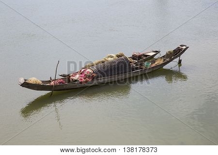 Lonely wooden boats on a river flowing into the sea in Asia
