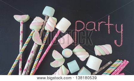 assorted marshmallow candies on a  black chalkboard