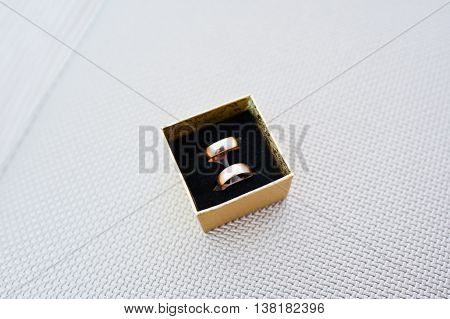 Wedding Rings On Golden Box Background Silver Texture