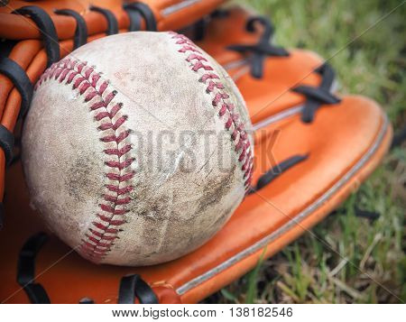 Nostalgic baseball in glove on a baseball field, Selective focus and close up image