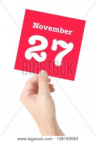 November 27 written on a card held by a hand