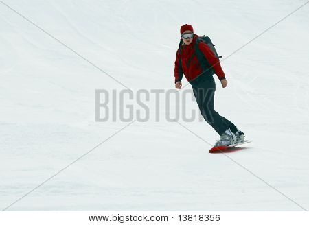 The snowboarder on snow slope
