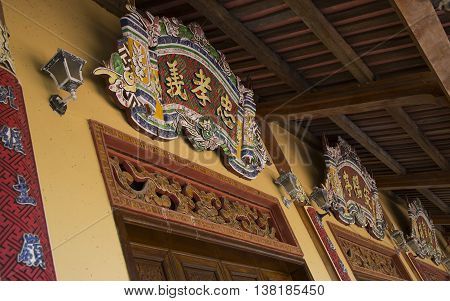 Hue, Vietnam - Jun 16, 2016: Close up of wooden details and decorations on the wall of Forbidden City of the Imperial Royal Palace of Nguyen dynasty.