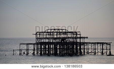 Derelict West Pier in Brighton, England at Sunset