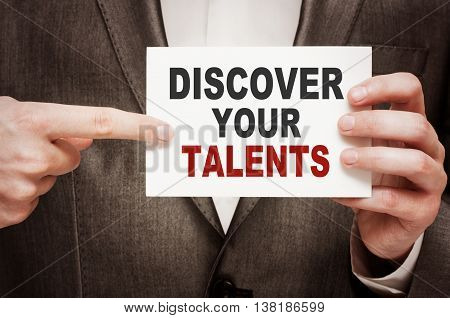 Discover Your Talents. Card with text in male hand