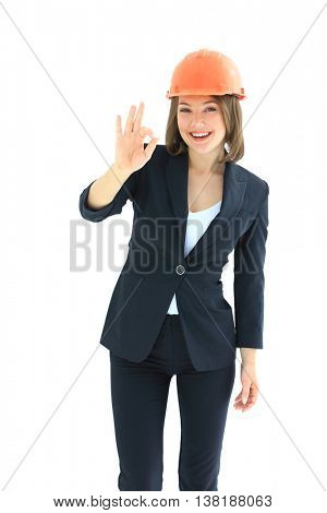 Young woman architect  showing OK