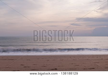 Evening landscape with the sea and the cloudy sky