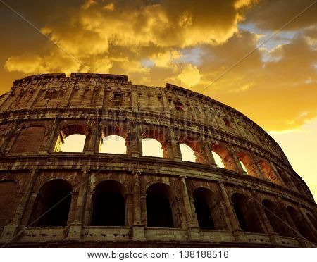 Colosseum in Rome with sunset sky in the background, Italy