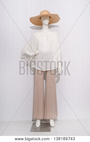 women dress with hat on dummy - full-length