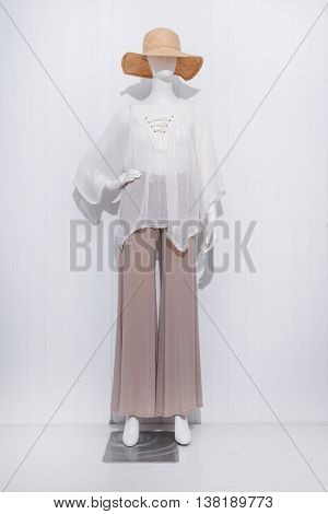full-length women dress with hat on dummy