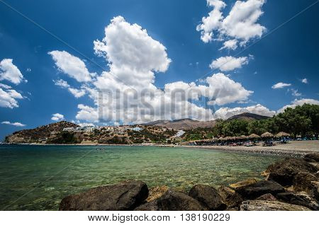 Agia Galini Beach in Crete island, Greece. Tourists relax and bath in crystal clear water of Agia Galini Beach.