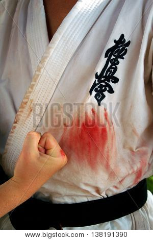 Alushta Ukraine - June 27. 2008: Blood stained uniform of the member of the international karate summer training camp.