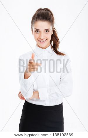 Young smiling beautiful businesswoman pointing at camera isolated on the white background