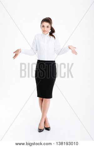 Portrait of a young beautiful businesswoman shrugging shoulders over white background