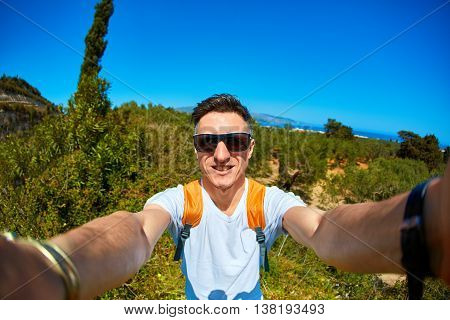 young man, photographer make selfie on the park background