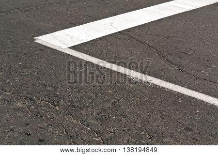 White Paint Mark On The Old Asphalt Road.