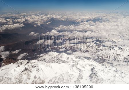 Snow capped mountains, aerial view above Afganistan
