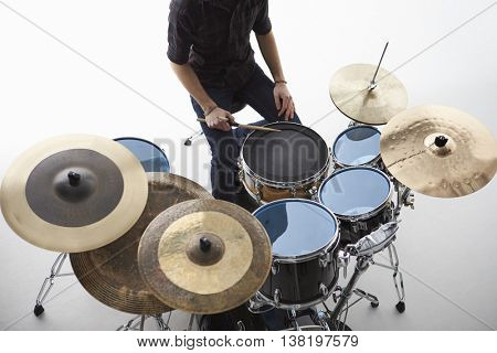 Overhead Shot Of Drummer Playing Drum Kit In Studio