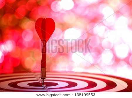 Target Dart With Arrow Over Blurred Bokeh Background
