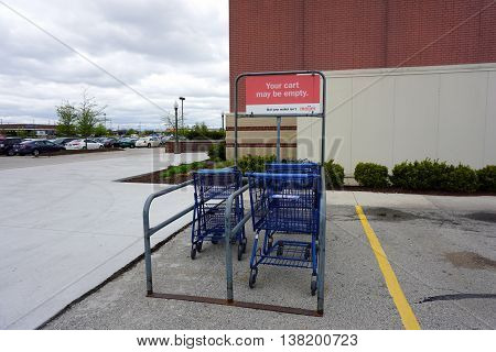 PLAINFIELD, ILLINOIS / UNITED STATES - MAY 4, 2016: Shoppers at the Meijer store may leave their shopping carts in a cart corral in the parking lot.
