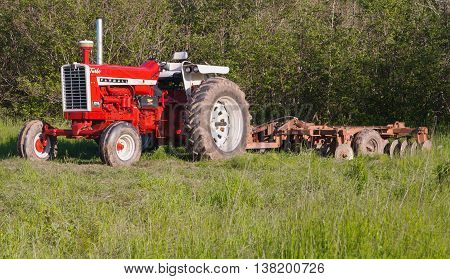 NOEL CANADA - JUNE 06 2016: Farmall was originally a specific model of tractor and later became a brand name for a line of tractors. Farmalls were manufactured by International Harvester.