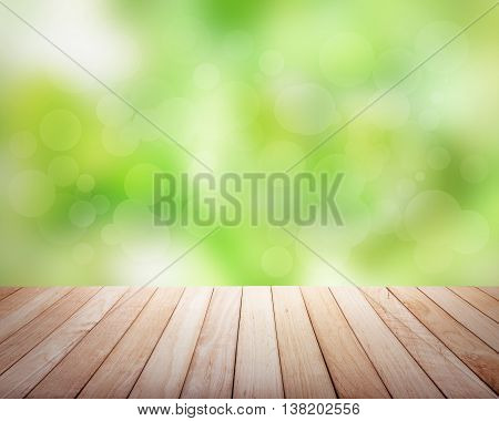 Wooden platform with green plants. Focus on platform.