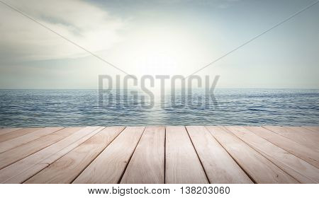 Empty wooden platform and beach lapped by the waves in vintage style.