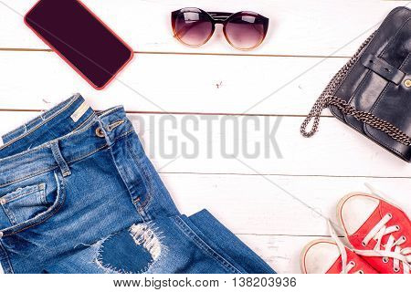 Women Clothing Set And Accessories On Light Background.top View, Different Shoes On Light Background