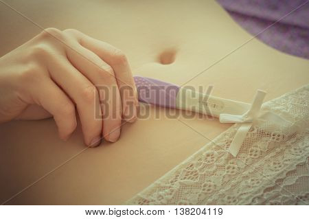 Pregnant Woman Holding Positive Pregnancy Test