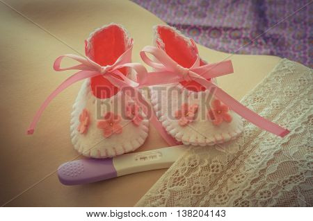 Newborn Baby Girl Booties And Pregnancy Test