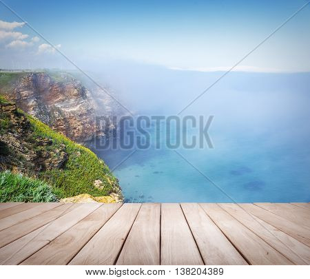 Empty wooden platform and Cape Kaliakra, Bulgaria. Rocky coast of Cape with sea views.