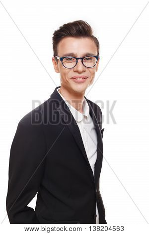 Young smiling man isolated at white. Portrait of confident guy looking at camera. Boy style, trendy male person in stylish eyeglasses and black suit. Modern businessman.