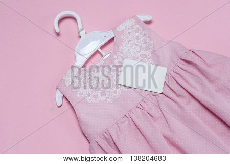 Clothes For Baby Girl On A Pink Background. Copy Space For Text