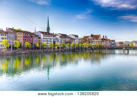 ZURICH SWITZERLAND - May 22 2016 - Beautiful view of the historic city center of Zurich with famous Fraumunster Church and swans on river Limmat on a sunny day with blue sky Canton of Zurich Switzerland.